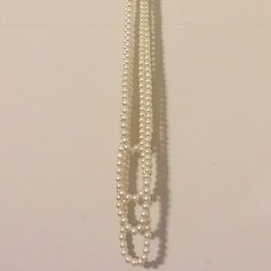 Long multi-strand faux pearl necklace